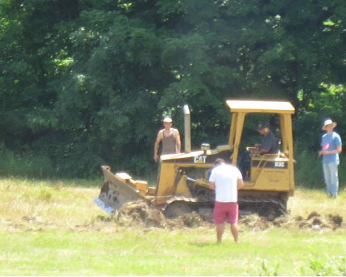 Bulldozer making water harvesting earthworks.
